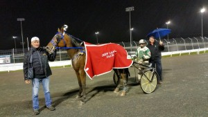 The weather did not deter Peterborough MPP and Minister of Agriculture Jeff Leal from presenting a cooler on closing night at Kawartha Downs to Macho Mass and driver Reg Gassien.