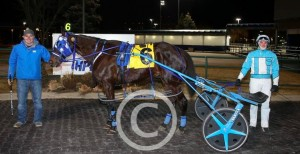 Tommy Riley and Travis Henry with Loves A Challenge after his win Monday night. (New Image Media)